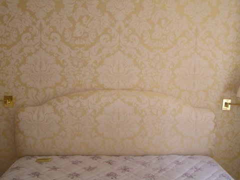 Headboard pattern matched with wall