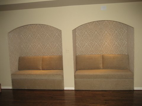 Upholstered walls with built-in love seats